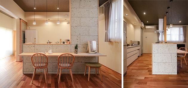 大谷石という天然石をはめ込んだキッチン壁面
